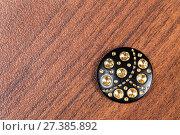 Купить «Black buttons with rhinestones on the wooden background», фото № 27385892, снято 4 июня 2015 г. (c) Евгений Ткачёв / Фотобанк Лори