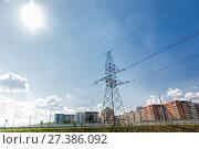 Купить «Part of the city, which forms the transmission line of electricity. Bright sun summer day», фото № 27386092, снято 6 августа 2014 г. (c) Евгений Ткачёв / Фотобанк Лори