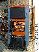 Solid fuel boiler for heating the house. Стоковое фото, фотограф Евгений Ткачёв / Фотобанк Лори