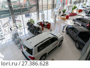 Купить «Selling cars Toyota in the showroom. New products automaker Toyota», фото № 27386628, снято 25 мая 2017 г. (c) Евгений Ткачёв / Фотобанк Лори