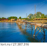 Beautiful view of a bamboo bridge. Laos landscape. Стоковое фото, фотограф Ольга Хорошунова / Фотобанк Лори