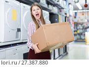 Купить «Portrait of happy young woman with box», фото № 27387880, снято 12 декабря 2017 г. (c) Яков Филимонов / Фотобанк Лори
