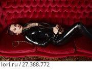 Купить «Beautiful fetish model in latex costume», фото № 27388772, снято 26 октября 2017 г. (c) Дмитрий Черевко / Фотобанк Лори
