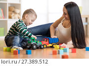 Mom and her toddler son plays with car in their living room. Стоковое фото, фотограф Оксана Кузьмина / Фотобанк Лори