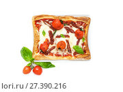 Купить «Square pizza in a country style with dried tomatoes, mozzarela and basil on a white background. Isolated.», фото № 27390216, снято 14 января 2018 г. (c) Olesya Tseytlin / Фотобанк Лори