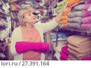 Купить «mature woman holding cotton colour towel in the textile shop», фото № 27391164, снято 29 ноября 2017 г. (c) Яков Филимонов / Фотобанк Лори