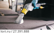 Купить «Workshop - cleaning of vehicle wardrobe with vacuum cleaner», видеоролик № 27391888, снято 20 августа 2019 г. (c) Константин Шишкин / Фотобанк Лори