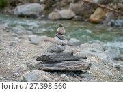 Купить «Пирамида из камней на берегу горной реки», фото № 27398560, снято 11 июля 2017 г. (c) Геннадий Соловьев / Фотобанк Лори