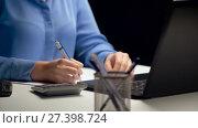 Купить «woman with calculator and laptop at night office», видеоролик № 27398724, снято 4 января 2018 г. (c) Syda Productions / Фотобанк Лори