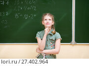 Купить «Schoolgirl in the classroom standing at the blackboard solves an elementary example in mathematics», фото № 27402964, снято 11 декабря 2018 г. (c) Оксана Кузьмина / Фотобанк Лори