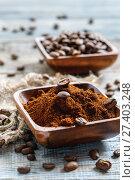 Купить «Ground coffee and coffee beans in a wooden bowl», фото № 27403248, снято 21 января 2017 г. (c) Марина Сапрунова / Фотобанк Лори