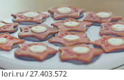 Купить «Baking Christmas gingerbread. Baking technology with specialized electrical equipment. Preparing for a festive fun.», видеоролик № 27403572, снято 21 октября 2017 г. (c) Mikhail Davidovich / Фотобанк Лори