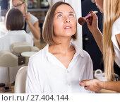Купить «female makeup artist applying cosmetics for woman», фото № 27404144, снято 22 сентября 2018 г. (c) Яков Филимонов / Фотобанк Лори