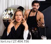 Купить «professional makeup artist with female shocked», фото № 27404156, снято 24 февраля 2018 г. (c) Яков Филимонов / Фотобанк Лори