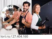 Купить «woman hairdresser and man makeup artist», фото № 27404160, снято 23 сентября 2018 г. (c) Яков Филимонов / Фотобанк Лори