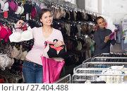 Купить «Cheerful woman shopping lace uplifts», фото № 27404488, снято 24 октября 2018 г. (c) Яков Филимонов / Фотобанк Лори