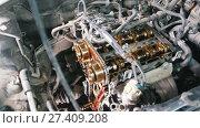 The internal combustion engine, disassembled, repair at car service, overhaul, under the hood of the car. Стоковое видео, видеограф Константин Шишкин / Фотобанк Лори