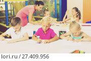 Купить «Kids sitting and listening teacher in elementary school», фото № 27409956, снято 20 мая 2019 г. (c) Яков Филимонов / Фотобанк Лори
