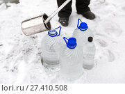 Купить «Man in special clothes collecting samples of water potentially contaminated by toxic material, in winter on the lake, in coal mine», фото № 27410508, снято 22 декабря 2017 г. (c) Сергей Тимофеев / Фотобанк Лори