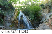 Купить «Foaming small waterfall in forest», видеоролик № 27411012, снято 3 июля 2017 г. (c) Tatiana Kravchenko / Фотобанк Лори