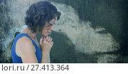 Купить «Composite image of upset woman with hands clasped», фото № 27413364, снято 16 августа 2018 г. (c) Wavebreak Media / Фотобанк Лори