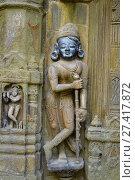 Купить «Sculpture of dwarpala on the wall of Trishund Mayureshshwar Ganesh Temple at Somawar Peth Pune Maharashtra India.», фото № 27417872, снято 28 октября 2017 г. (c) age Fotostock / Фотобанк Лори