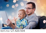 Купить «Father and son with tablet pc playing at home», фото № 27420504, снято 19 марта 2016 г. (c) easy Fotostock / Фотобанк Лори