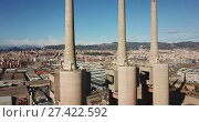 Купить «chimneys of closed power thermal station. Barcelona», видеоролик № 27422592, снято 16 января 2018 г. (c) Яков Филимонов / Фотобанк Лори