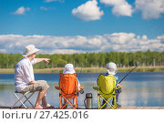 Купить «man and sons sit on the pier and fishing», фото № 27425016, снято 14 июня 2016 г. (c) Константин Лабунский / Фотобанк Лори