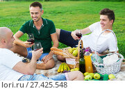 Купить «Males friends enjoying picnic», фото № 27425548, снято 23 августа 2017 г. (c) Яков Филимонов / Фотобанк Лори