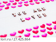 Купить «Valentines day background. Silk hearts and inscription You are loved on the white wooden background, St Valentines day concept», фото № 27425864, снято 21 января 2018 г. (c) Зезелина Марина / Фотобанк Лори