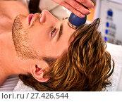 Купить «Ultrasonic facial treatment on ultrasound man face machine.», фото № 27426544, снято 12 октября 2015 г. (c) Gennadiy Poznyakov / Фотобанк Лори