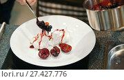 Купить «Woman on the kitchen adds fruit confiture for dessert -Pavlova cake - close up», видеоролик № 27427776, снято 30 мая 2020 г. (c) Константин Шишкин / Фотобанк Лори