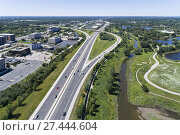 Купить «Aerial view of a highways, overpasses, ramps and buildings in the Chicago suburban area of Northbrook, IL. USA.», фото № 27444604, снято 29 июля 2017 г. (c) age Fotostock / Фотобанк Лори