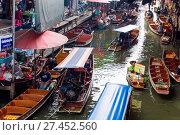 Купить «Asia, Thailand, Bangkok, Damnoen Saduak floating market», фото № 27452560, снято 6 сентября 2017 г. (c) age Fotostock / Фотобанк Лори