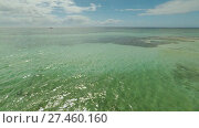 Купить «Aerial view of Bohol coast Island. Aerial. Flight is close above the water. Philippines.», видеоролик № 27460160, снято 20 января 2018 г. (c) Mikhail Davidovich / Фотобанк Лори