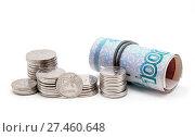 Купить «Российские рубли на белом фоне», фото № 27460648, снято 23 января 2018 г. (c) Наталья Осипова / Фотобанк Лори
