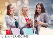 Купить «happy women with smartphones and shopping bags», фото № 27460948, снято 3 ноября 2014 г. (c) Syda Productions / Фотобанк Лори