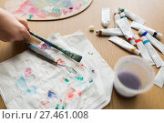 Купить «artist hand with paintbrush, paper and paint tubes», фото № 27461008, снято 1 июня 2017 г. (c) Syda Productions / Фотобанк Лори