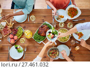 Купить «group of people eating at table with food», фото № 27461032, снято 5 октября 2017 г. (c) Syda Productions / Фотобанк Лори