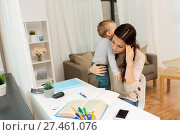 Купить «mother student with baby learning at home», фото № 27461076, снято 1 декабря 2017 г. (c) Syda Productions / Фотобанк Лори