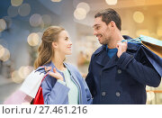 Купить «happy young couple with shopping bags in mall», фото № 27461216, снято 10 ноября 2014 г. (c) Syda Productions / Фотобанк Лори