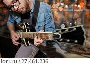 Купить «musician playing guitar at studio or music concert», фото № 27461236, снято 18 августа 2016 г. (c) Syda Productions / Фотобанк Лори