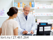 Купить «senior apothecary with prescription at pharmacy», фото № 27461264, снято 27 июня 2015 г. (c) Syda Productions / Фотобанк Лори