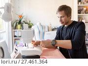 Купить «fashion designer with sewing machine at studio», фото № 27461364, снято 28 июня 2017 г. (c) Syda Productions / Фотобанк Лори