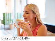 Купить «close up of woman drinking coffee at restaurant», фото № 27461404, снято 17 августа 2017 г. (c) Syda Productions / Фотобанк Лори