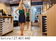 Купить «young woman in high-heeled shoes at store mirror», фото № 27461440, снято 22 сентября 2017 г. (c) Syda Productions / Фотобанк Лори