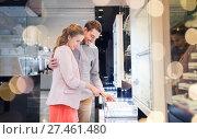 Купить «happy couple choosing engagement ring in mall», фото № 27461480, снято 10 ноября 2014 г. (c) Syda Productions / Фотобанк Лори