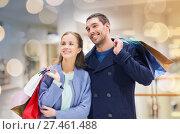 Купить «happy young couple with shopping bags in mall», фото № 27461488, снято 10 ноября 2014 г. (c) Syda Productions / Фотобанк Лори