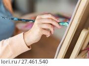 Купить «hand of artist with brush painting at art studio», фото № 27461540, снято 1 июня 2017 г. (c) Syda Productions / Фотобанк Лори